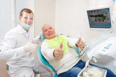 senior with oral surgeon getting procedure done