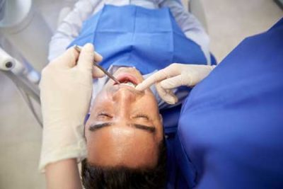 man getting oral exam at the dentist