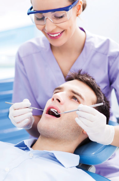 endodontist working on a patient