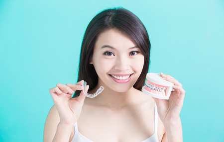 woman holing invisalign